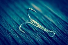 Les hameçons pointus ont photographié le plan rapproché Le crochet affilé ne donnera pas une occasion de pêcher pour s'échapper d Photo stock