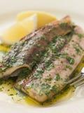 Les harengs de Fyne de loch ont grillé avec du beurre de persil Image libre de droits