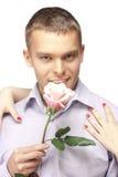 Les hommes avec le rose se sont levés Photo libre de droits