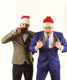 Les hommes d'affaires avec les visages faisants rage montrent la puissance et la confiance photographie stock libre de droits