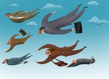 Les hommes d'affaires volent dans le ciel Photographie stock