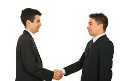 Les hommes heureux d'affaires donne la prise de contact Images stock