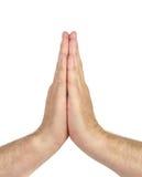Les hommes remet symboliser ensemble la prière sur le blanc Photos libres de droits