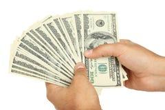 Les hommes remettent tenir cent billets d'un dollar sur le fond blanc Image libre de droits