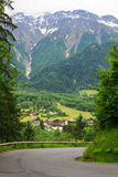 Les Houches, France. Road to Les Houches, France. In the background Alpine mountains Royalty Free Stock Photography