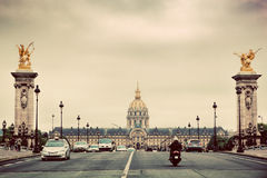 Les Invalides seen from Pont Alexandre III bridge in Paris, France. Vintage Stock Images