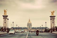 Les Invalides seen from Pont Alexandre III bridge in Paris, France. Vintage Stock Images