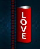 Les jeans cousent avec le label rouge d'amour Images libres de droits