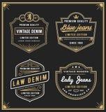 Les jeans de denim de vintage encadrent le logo pour vos affaires Images libres de droits