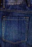 Les jeans desserrent la poche image stock