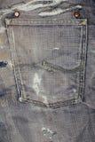 Les jeans donnent à la verticale une consistance rugueuse Photographie stock