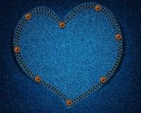 Les jeans donnent une consistance rugueuse avec le coeur Photographie stock libre de droits