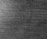 Les jeans donnent une consistance rugueuse en noir et blanc Photos libres de droits