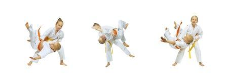 Les jets de judo font le collage d'enfants Photographie stock libre de droits