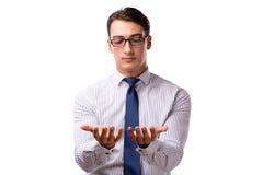 Les jeunes boutons beaux de pressing d'homme d'affaires d'isolement sur le blanc Photo stock