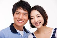 Les jeunes couples asiatiques se ferment vers le haut du tir Image libre de droits