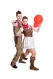 Les jeunes couples ont l'amusement dans le temps de carnaval - d'isolement sur le blanc Photographie stock