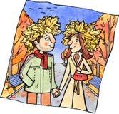 Les jeunes couples sur une promenade pendant l'automne se garent Image stock