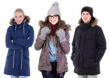 Les jeunes dans des vêtements d'hiver d'isolement sur le blanc Images stock