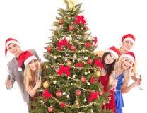 Les jeunes de groupe dans le chapeau de Santa. Photos libres de droits