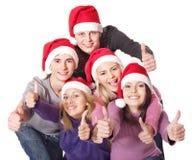 Les jeunes de groupe dans le chapeau de Santa. Image stock