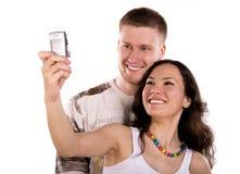 Les jeunes prennent une photo d'eux-mêmes Photographie stock