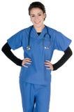 Les jeunes soignent, bleu frottent et stéthoscope, d'isolement image stock