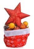 Les jouets de Noël d'esprit de sac du père noël et l'agrostide blanche se tiennent le premier rôle Photographie stock