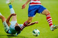Les joueurs de football inconnus exécute Images stock