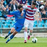 Les joueurs de football inconnus exécute Images libres de droits
