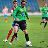 Les joueurs de football inconnus exécute Image libre de droits