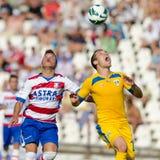 Les joueurs de football inconnus exécute Image stock