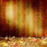 Les lames tombées sur le mur de fond Photo stock