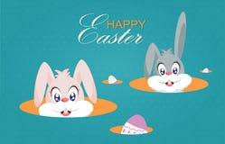 Les lapins de Pâques ou les lapins de Pâques et les oeufs de pâques mignons ont isolé o Image libre de droits