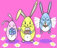 Les lapins Pâques durcit avec des oeufs Image stock