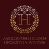 Les lettres de découpe d'or de vrilles avec H parafent le monogramme Images libres de droits
