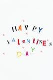 Les lettres de jour heureuses de valentines ont coupé des magazines Images stock