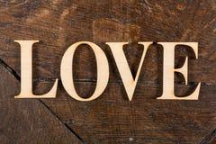 Lettres en bois sur le fond en bois Images libres de droits