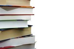 les livres de fond d'isolement empilent le blanc Image stock