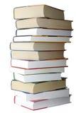 les livres de fond d'isolement empilent le blanc Photos stock