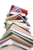Les livres empilent d'isolement sur le blanc Photos libres de droits