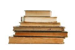 les livres ont isolé la vieille pile Photos stock