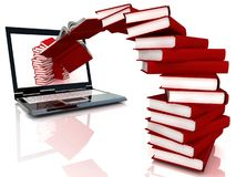 Les livres rouges volent dans l'ordinateur portatif Photos stock