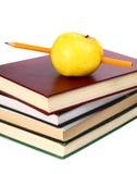 Les livres sont une pomme et un crayon Photos libres de droits
