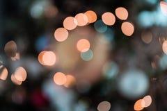 Les lumières de Bokeh soustraient le fond coloré photographie stock libre de droits