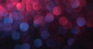Les lumières de la haute définition ont brouillé les milieux abstraits de bokeh banque de vidéos