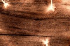 Les lumières de Noël rougeoyantes abstraites en guirlande forment, carte de voeux Photos stock
