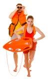 Les maître nageurs dans le gilet de vie avec la délivrance maintiennent à flot le fonctionnement Photos libres de droits