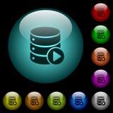 Les macro icônes de jeu de base de données en couleurs ont illuminé les boutons en verre Photo libre de droits