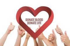 Les mains avec donnent le sang donnent le texte de la vie et un graphique de coeur Photos stock